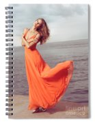 Young Woman In Orange Dress Flying In The Wind At Sea Shore Spiral Notebook