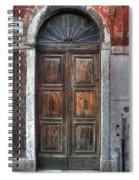 an old wooden door in Italy Spiral Notebook