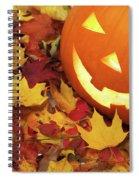 Carved Pumpkin On Fallen Leaves Spiral Notebook