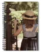 Girl Looking Over Iron Gate Spiral Notebook