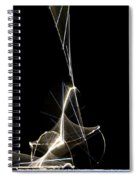 High Speed Strobe Image Of Pin Dropping Spiral Notebook