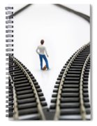 Figurine Between Two Tracks Leading Into Different Directions Symbolic Image For Making Decisions. Spiral Notebook