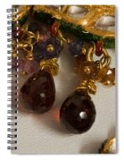3 Hanging Semi-precious Stones Attached To A Green And Gold Necklace Spiral Notebook