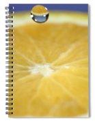 Drip Over An Orange Spiral Notebook