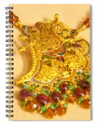 A Beautiful Intricately Carved Gold Pendant Hanging From A Semi-precious Stone Chain Spiral Notebook