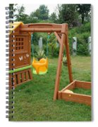 A Childs Playing Equipment In A Green Location Spiral Notebook