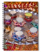 A Decorated Hindu Prayer Thaali With Wax Candles Oil Lamps Spiral Notebook
