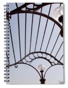 A Metal Structure That Is Part Of The Lamp Shade Arrangement In A Garden Spiral Notebook