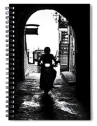 a scooter rider in the back light in a narrow street in Italy Spiral Notebook