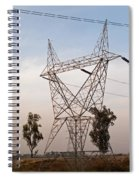 A Transmission Tower Carrying Electric Lines In The Countryside Spiral Notebook