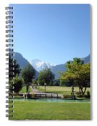 An Open Field In Interlaken With A View Of The Mountains In The Background Spiral Notebook