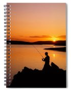 Angler At Sunset, Roaring Water Bay, Co Spiral Notebook