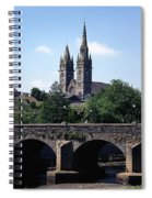 Arch Bridge Across A River With A Spiral Notebook