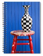 Blach And White Vase On Stool Against Blue Wall Spiral Notebook