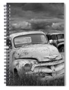 Black And White Photograph Of A Junk Yard With Vintage Auto Bodies Spiral Notebook