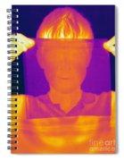 Boy Holding Black Plastic Spiral Notebook