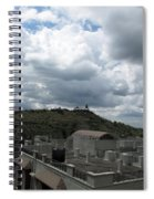 Buildings Cover The Lower Section Of A Hill That Has A Temple At The Top With Clouds Covering The Sk Spiral Notebook