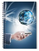 Businessman Holding Mobile Phone With Globe Spiral Notebook