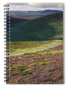 Country Road Passing Through A Spiral Notebook