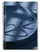Eye Glasses On A Plate In Blue Spiral Notebook