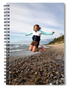 Girl Jumping At Lake Superior Shore Spiral Notebook