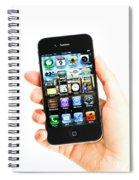 Hand Holding An Iphone Spiral Notebook