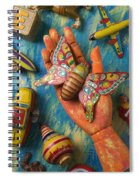 Hand Holding Butterfly Toy Spiral Notebook