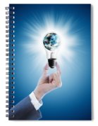 Hand Holding Light Bulb With Globe  Spiral Notebook