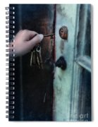Hand Putting Vintage Key Into Lock Spiral Notebook
