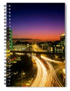 High Angle View Of Traffic Moving In A Spiral Notebook