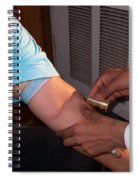 Inserting The First Part Of The Blood Test Collection Apparatus Spiral Notebook