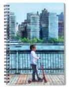 Little Girl On Scooter By Manhattan Skyline Spiral Notebook