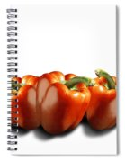 Red Peppers On White Spiral Notebook