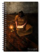 Schoolgirl Sitting On Wood Floor Reading By Candlelight Spiral Notebook