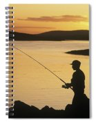 Silhouette Of A Fisherman Fishing On Spiral Notebook
