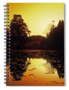 Silhouetted Home And Trees Near Water Spiral Notebook