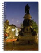 Statue Of A Man On A Pedestal On The Spiral Notebook