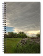 Storm Clouds Gather Over An Abandoned Spiral Notebook