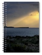 storm light - A morning light iluminates lighthouse through clouds in an amazing landscape Spiral Notebook