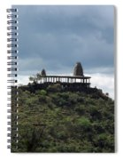 The Structure Of An Abandoned Temple On The Top Of A Green Covered Hill With Blue And White Clouds I Spiral Notebook