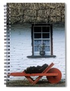 Wheelbarrow In Front Of A Window Of A Spiral Notebook