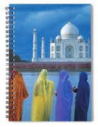 Women In Colorful Saris In Front Of The Spiral Notebook