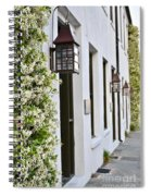 Colonial Home Exterior With Vertical Plants And Old Lanterns Displayed On The Side Of Home Spiral Notebook