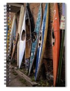 Kayaks Lined Up On Wall Spiral Notebook