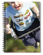 Young Boy Smiling Swinging In A Swing Spiral Notebook