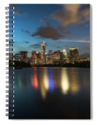 Clouds Roll Over The Austin Skyline As The Neon Reflects In The Glass-like Waters Of Lady Bird Lake Spiral Notebook