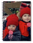 Two Children Sitting On A Bench With Candy Spiral Notebook