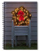 Christmas Wreath On Lawn Chairs Spiral Notebook
