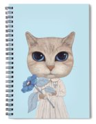 A Cat With A Blue Flower On White Spiral Notebook