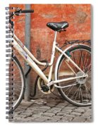 A Dejected Bicycle Waits Patiently On A Cobbled Street In Rome. Spiral Notebook